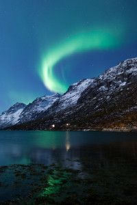 Northern Lights (Aurora Borealis) reflected across fjords